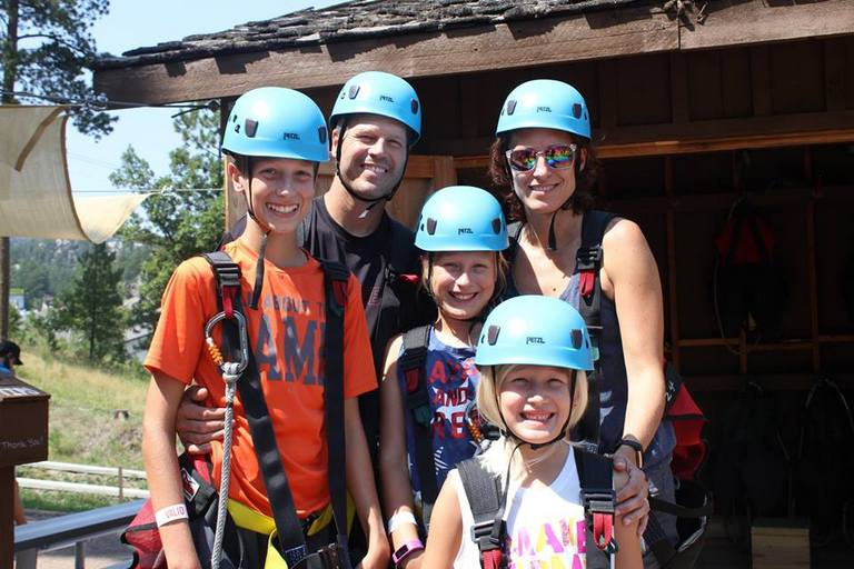 A Family of 5 people during a visit to Rushmore Tramway. Just about to start ziplining