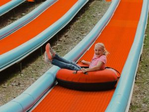 Little girl enjoying the Tubing Hill adventure in 2019