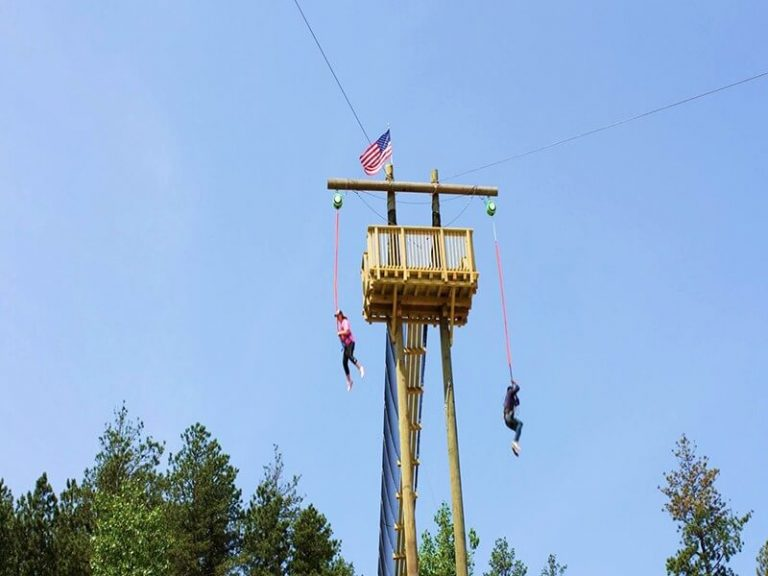 A couple jumping of both sides of the Jump Tower! Lots of adrenaline guaranteed