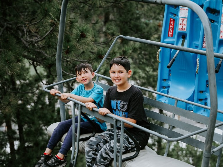 Two kids riding the chairlift